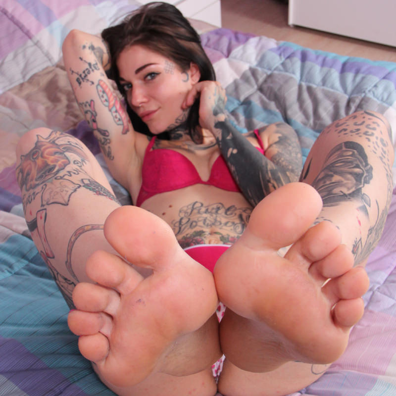 A sexy, hot, girl puts her feet on your face!